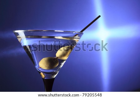 martini and green olives - stock photo
