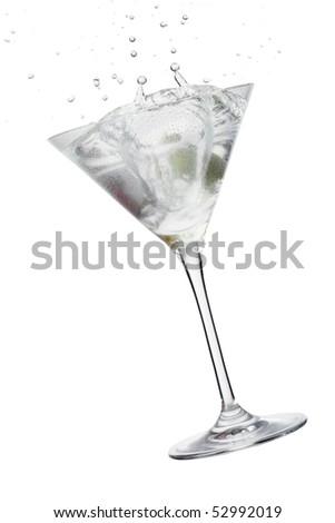 Martini glass,Cocktail with Olive splash - stock photo
