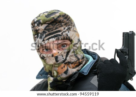 masked man holding a pistol over white