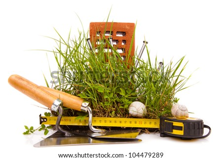 mason tools and green grass - stock photo