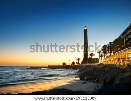 Maspalomas Lighthouse at sunset. Gran Canaria.  - stock photo