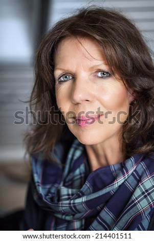 Mature lady looking relaxed at camera - stock photo