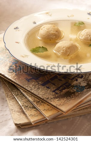Matzo ball soup with parsley leaves. - stock photo