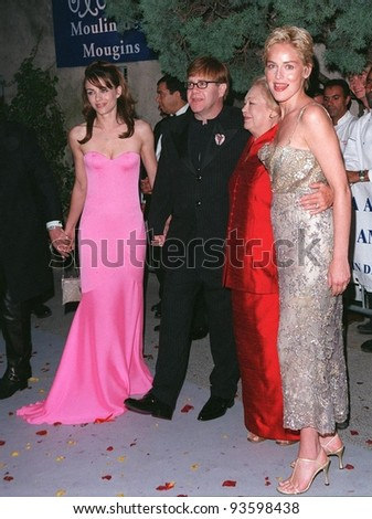 21MAY98:  Actress SHARON STONE (right) with ELIZABETH HURLEY, SIR ELTON JOHN & DR. MATHILDE KRIM at AmFAR's Cinema Against AIDS gala at Moulin de Mougins, France.