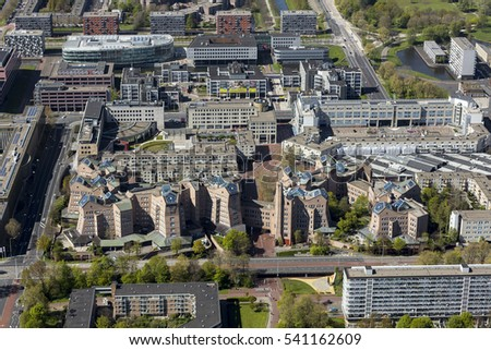 1 May 2016, Amsterdam Bijlmermeer, Netherlands. Aerial view of headquarters of ING Bank in the Bijlmer with shopping mall Arenapoort and an apartment building.