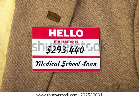 Medical School student loan name badge on jacket. - stock photo