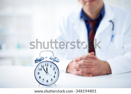 medicine, health and hospital concept - ]it's time to visit your doctor - stock photo