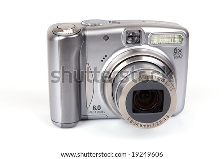 8 megapixel digital camera on isolated white background.