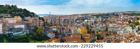 30 Megapixels Panorama view of old town Lisbon and Sao Jorge Castle, the capital and the largest city of Portugal. - stock photo