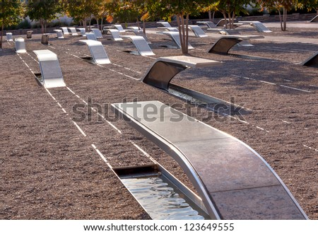 911 Memorial Victims Pentagon Attack in Arlington Virginia in the Washington DC Metropolitan area.  Markers have name each victim in the 911 attack.  Victims civilian government workers and military. - stock photo