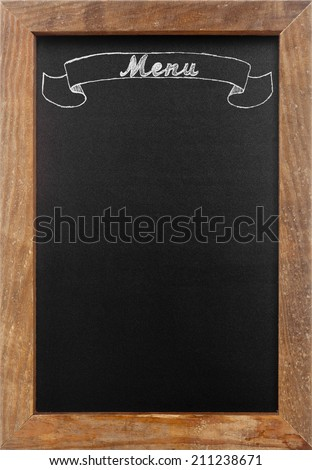 'Menu' chalk writing on old vintage chalkboard with copy space - stock photo