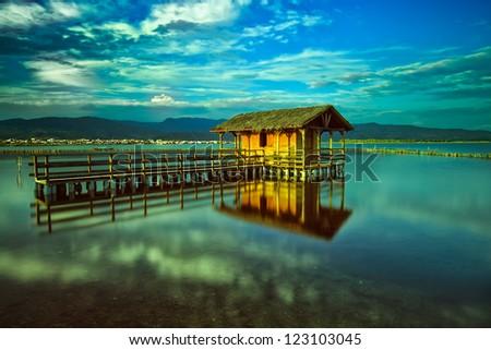 Mesologgi a Fishing Hut in Lagoon. - stock photo