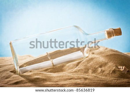 ,message in bottle on sand, - stock photo