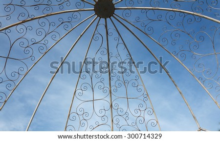 metal flower  spiral decorations on a sky background - stock photo