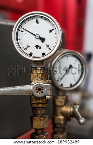 2 metal industrial pressure gauges - stock photo
