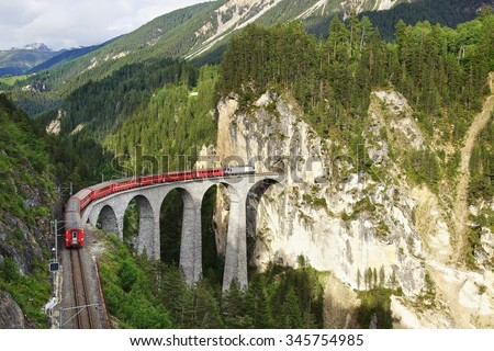 65 metre high Landwasser Viaduct with train at Filisur, Switzerland - stock photo