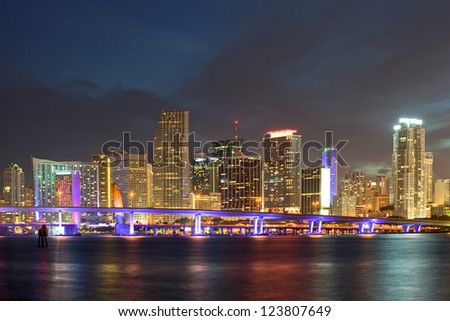 Miami Florida  downtown illuminated business and luxury residential buildings, hotels and Biscayne Bay bridge.Night Cityscape of World famous travel location. - stock photo