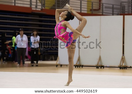 Michele Lau of Singapore  in action with hoop at Rhythmic Gymnastics during the13th Singapore Open Gymnastics Championship 2016 at Bishan Sports Hall on June 26, 2016 in Singapore - stock photo