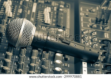Microphone, sound, mixer, professional,Audio mixer and microphone in black and white image.