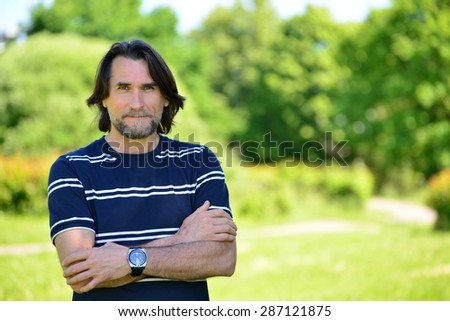 Middle Age Man Standing Outdoors  in summer - stock photo