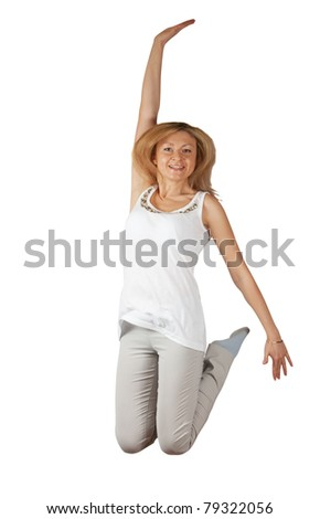 middle aged woman jumping isolated on white - stock photo