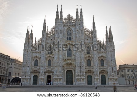 Milan - westfacade of cathedral and square in morning - stock photo