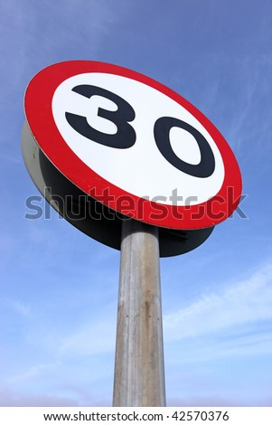 30 miles an hour speed limit sign. - stock photo