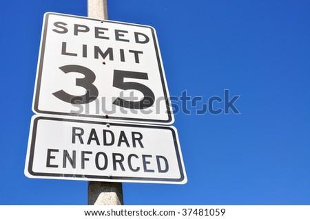 35 miles per hour sign, radar enforced - stock photo
