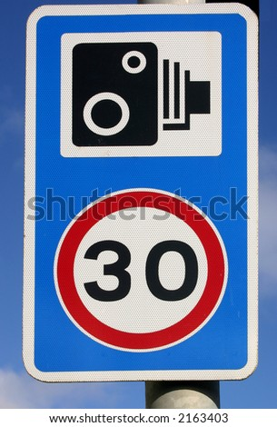 30 miles per hour speed and speed camera sign. - stock photo