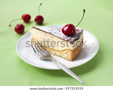 Milk souffle (bird's milk) cake with fresh cherry - stock photo
