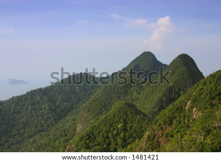 600 million year-old mountains on the tropical island of Langkawi, Malaysia-Horizontal Format - stock photo