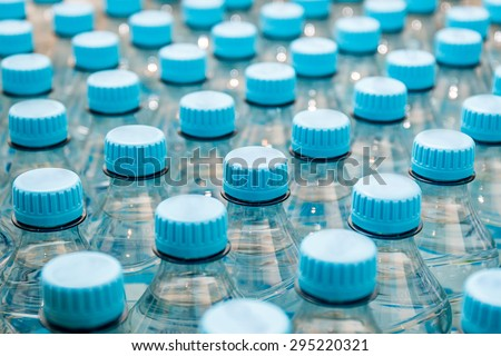 Mineral water bottles - plastic bottles - stock photo