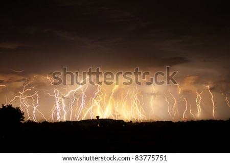 15 minute exposure of a distant storm that produced about 120 bolts of lightning in that time. - stock photo
