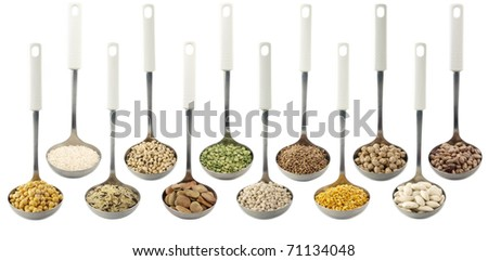 Misc legumes types over spoons - stock photo