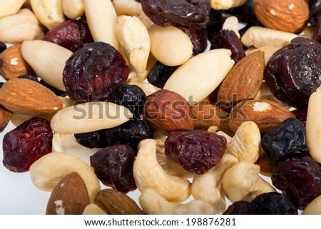 mixed nuts and dried fruits isolated on white background - stock photo