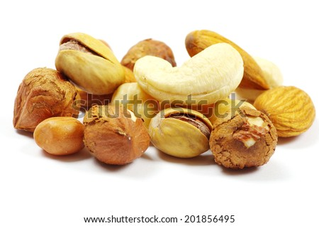 mixed nuts on white background - stock photo