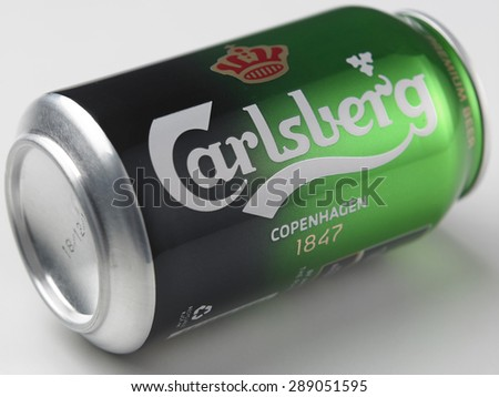 325ml can of Carlsberg lager Isolated On White Background. The Carlsberg Group is a Danish brewing company founded in 1847.