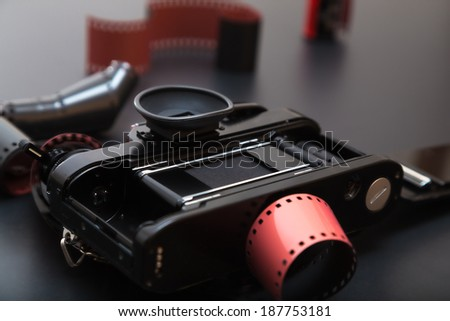 35mm analog reflex camera lying down on its roll film