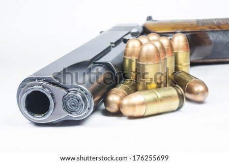 11 mm. Black handgun And ammunition isolated on white  - stock photo