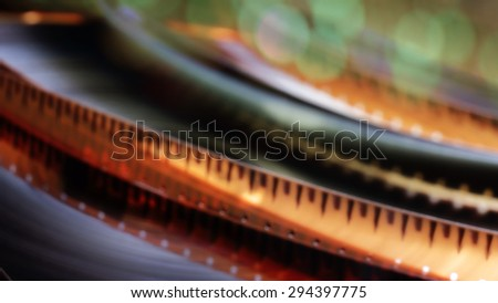16 mm. blurred motion film reel. - stock photo