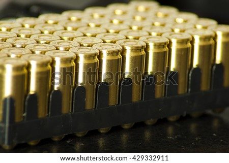 9mm bullets for a gun isolated on dark background. - stock photo