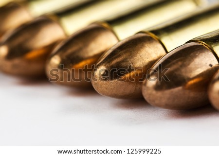 9 mm bullets on a white background isolated