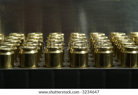 9mm bullets stacked in a plastic case - stock photo