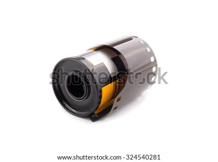 35 mm color film cartridge on white background. - stock photo