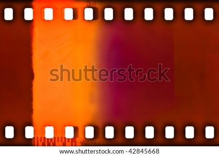 35mm color film strip sample with light leak - stock photo