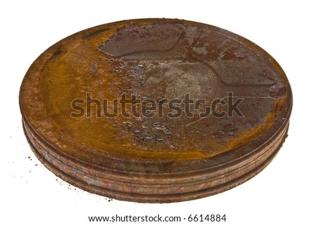 35 mm film oxidized can isolated in white background - stock photo