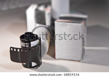 35mm film roll and boxes - stock photo