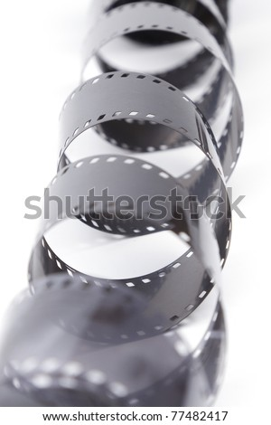 35mm film spiral on white background \35mm film negative - stock photo