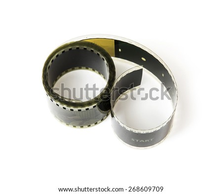 8mm film tape on the white background. Cinema theme. - stock photo