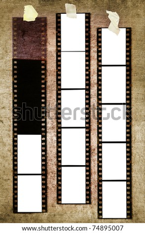 35 mm filmstrip, picture frames, on grungy background - stock photo